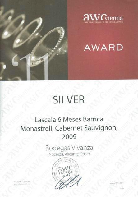 Diploma concedido en la feria «International Wine Challenge – AWC-Vienna 2011». Galardonado con la medalla de plata por el vino Lascala 6 Meses Barrica Monastrell, Cabernet Sauvignon, 2009